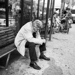 Lonely man and a family (Eric_G73) Tags: candid candidphotography street streetphotography