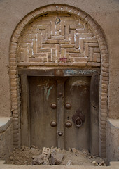 Old wooden door sinking in the ground, Yazd province, Yazd, Iran (Eric Lafforgue) Tags: 0people ancient architectural architecture brick building colorimage door entrance fulllenght house iran iranian middleeast nopeople nobody old outdoors persia persian photography sinking traditional traditionalhouse vertical wood wooden yazd yazdprovince ir