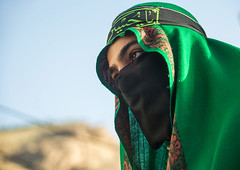 Iranian shiite muslim man with his face hidden by a veil mourning imam hussein on tasua during the chehel manbar ceremony one day before ashura, Lorestan province, Khorramabad, Iran (Eric Lafforgue) Tags: 1people 20s 30sadult adult adultsonly ashura celebration ceremony colorimage commemoration copyspace covered hidden horizontal imamhussein iran islam khorramabad man memorialevent middleeast mourner mourning muharram muslim mystery onemanonly oneperson outdoors persian portrait religion religious ritual script shia shiism shiite tasua lorestanprovince