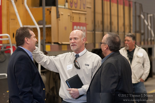 "Discussions before the ceremony<br /><span style=""font-size:0.8em;"">Tony Giobbie, CSX's Manager of Regional and Short Line Development, talks with a couple other guests in the engine house.</span> • <a style=""font-size:0.8em;"" href=""http://www.flickr.com/photos/20365595@N04/7050742603/"" target=""_blank"">View on Flickr</a>"