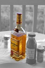 Bottled gold. (txdragonfly11) Tags: city yellow bottle picnic florida sony tequila liquor panama selectivecolor odc odc2 ourdailychallenge slta55v