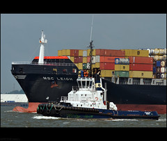 With Tug (peterphotographic) Tags: uk sea england water coast boat suffolk nikon ship harbour britain sigma container bow tug felixstowe vissel sigma70210f28 portoffelixstowe d300s dsc8188edwm