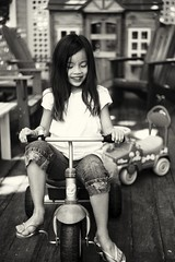 My old tricycle (berniechow) Tags: leica blackandwhite girl smile kids play tricycle deck