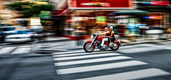 One Hot Mess (c. Melon Images) Tags: street city red summer woman man motion philadelphia lines bike canon couple vibrant shapes philly panning motorcyle canon1740