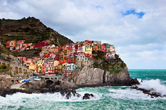 Manorolla in the Sun (phototractatus) Tags: ocean longexposure sea sky italy color nature water clouds canon coast town italian waves crash hike cliffs trail filter cinqueterre wilderness lands lanscape foreground graduated density neutral gnd singhray 5dmkii jaredropelato ropelatophotography