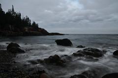 (The Pootie (Lisa)) Tags: pebble rocks coastline maine barharbor acadia nationalpark trees pine ocean sea waves longexposures nikon sky autumn