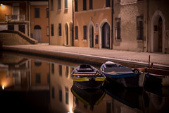 Comacchio - small fishing boats (_ Nemo _) Tags: comacchio ferrara italy historical onthewater water sony ilce7r contax vintagelens manual night silence quiet calma silenzio channels canali notte reflections riflessi planar 85mm 8514 f14 boats fisherman tradition northeast