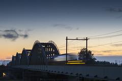 Edithbridge (Ravenstein - Nifterik) (alexknip) Tags: railway railwaybridge nederlandsespoorwegen dutchnationalrailway ravenstein nifterik maas bluesky blauwelucht verstijfdestaafboogbrug langersebrug sunset longshutter longexposure