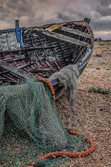 Hanging out the nets (James Waghorn) Tags: wreck autumn beach net dungeness pebbles boat nikkor35mmf18 kent d7100 clouds england bleak alone solitude abandoned prime