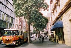 Sydney (goodfella2459) Tags: nikon f4 af nikkor 24mm f28d lens cinestill 50 35mm c41 film analog colour sydney street streets people fire truck firefighters milf