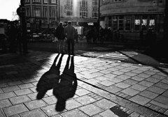 being followed (White_V) Tags: road street shadow sunlight man men london standing shadows wb shops camdentown