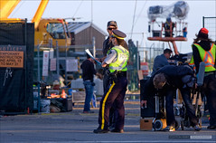 Security (Clayton Perry Photoworks) Tags: film set vancouver movie boat gun police richmond godzilla policewoman rcmp prop steveston warnerbros toho garrypointpark ussalameda godzilla2014