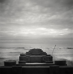 Untitled (Owen Luther) Tags: ocean morning sea seascape 6x6 film beach fog analog sunrise mediumformat square newjersey sand waves kodak trix gray nj spray hasselblad hasselblad500cm owenluther