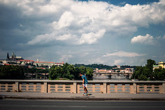 wild rider (ewitsoe) Tags: bridge trees summer sky storm hot castle water rain clouds 35mm river kid nikon warm punk prague bridges sunny praha praga skate skateboard czechrepublic skater rider thrasher d80 massivestorm ewitsoe