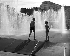 Rain Shower at South Bank (Claire_Sambrook) Tags: red people green london water rain yellow architecture concrete shower shadows southbank urbangarden brutalist nationaltheatre theshed