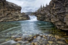Elbow Falls from below (John Andersen (JPAndersen images)) Tags: alberta clouds elbowfalls kananaskis landscape longexposure morning mountains purple river sky