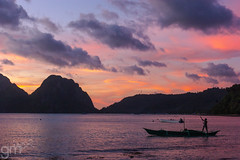 Packing up for the Day (-gunjan) Tags: landscape travel wanderlust ocean water sky boat philippines elnido sunset fisherman silhouette island palawan