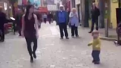 WATCH Adorable moment toddler shows off his moves as he copies Irish dancing street performer in fro (pahlawi27) Tags: watch adorable moment toddler shows off his moves he copies irish dancing street performer fro