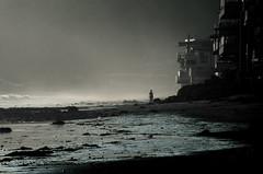 Destroyer Of Worlds (blueteeth) Tags: girl silhouette beach coast mist seaspray dark foreboding