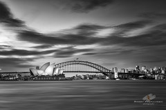 City Limits 2 (Bobby Krstanoski - Photography) Tags: australia blackwhite bridge buildings canon canon5dmarkiii canonef1635f28 cityscapes eastcoastaustralia fineart harbour kirribilli landscape nsw operahouse outdoor places seascapes skyline summer sunset sydney sydneyharbour sydneyharbourbridge sydneyhistory