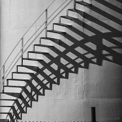 watch your steps (and their shadow) (lunaryuna) Tags: iceland northwesticeland siglufjordur harbour fueltanks spiralstaircase shadow abstract blackwhite bw monochrome lunaryuna squareformat