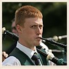 Piper (FotoFling Scotland) Tags: 2007 inverkeithinghighlandgames piper ginger bagpipe male face