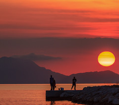 People & Sunset  - Sivota Harbour - Greece  (Canon EOS 7D & EF-S 55-250mm Telephoto Zoom) (1 of 1) (markdbaynham) Tags: greece sivota harbour town hellas hellenic grecia greka sunset colour sky cloud view canon canonite canonites eos 7d apsc dslr efs 55250mm telephoto zoom