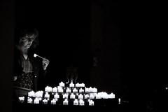 Harmonization of Darkness (catarinae) Tags: the harmonization darkness woman bw black white portrait old candles tea light church munich mnchen peterskirche st peters lit fire