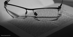 Reading (norm.edwards) Tags: flash eyewear book reading glasses glass words printed print look wow nice blackandwhite black white cool