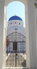 Through the arch to the Church ((Sue Lockhart Images)) Tags: church gate sky archway blue white
