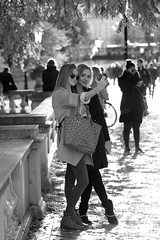 The light was so good... (PIXXELGAMES - Robert Krenker) Tags: newspaper news cafe kaffee vienna wien snapshot unknown candid portrait portret schwarzweiss blackandwhite blacknwhite bnw fujifilm fujinon filmsimulation lifestyle street streetstyle urban streetphotographer streetphotography biancoenero twogirls girls younggirls teens light against people group shining sun selfie bokeh