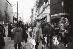 Oxford Street (goodfella2459) Tags: nikon f4 kodak trix 400 35mm black white film analog oxford street london people pedestrians costume uk milf