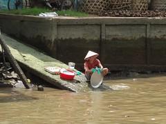 Clean dishes (program monkey) Tags: cleandishwash vietnam mekong river delta cargo boat ben tre tra vinh