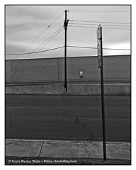 One Photo from Texas (Doyle Wesley Walls) Tags: lagniappe 1075 street building sign text sky powerlines blackandwhite photograph smartphonephoto iphonephoto doylewesleywalls