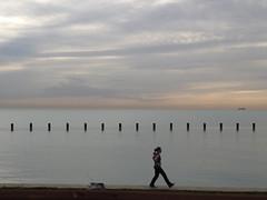 Walk Tall (michael.veltman) Tags: woman lake chicago water clouds walking illinois walk michigan tone wavebreakers