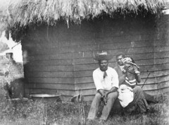 Two Australian South Sea Islander servants and child at Gairloch, Queensland (State Library of Queensland, Australia) Tags: queensland gairloch ingham statelibraryofqueensland thatchroof slq australiansouthseaislanders horizontalweatherboard