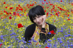 Brunette on flowers (Elisa Bistocchi) Tags: park travel flowers summer portrait woman holiday nature girl face field grass rural season expression meadow human brunette papaveri peole sibillini lenticchie fiordalisi castellucciodinorcia piangrande