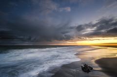 West Coast Demons (Nick Twyford) Tags: longexposure sunset newzealand clouds reflections blacksand lowlight nikon whitewater waves wideangle nopeople auckland nz northisland westcoast whatipu colourimage leefilters 1024mm d7000 ninepinrock lee09nd lee06gndhard phottixgeoone