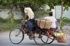 MM025 Going to the marketplace - Mandalay (VesperTokyo) Tags: street morning woman man yellow cyclist burma mango worker myanmar porter burmese sandal mandalay longyi bicycletaxi cyclerickshaw sicar nikond3