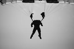 Headless parachutist... (tvdflickr) Tags: sky blackandwhite white man black men monochrome silhouette clouds soldier army skydive goldeneagle parachute usarmy paratrooper parachuteteam ripcord nikonflickraward