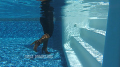 Playing in the Pool in Spandex Pants & Knee Boots (Fanta_Productions) Tags: underwater underwaterfetish wetlook wetboots nobra spandex spandexleggings kneeboots kneehighboots tallboots curvywomen videoscreenshot