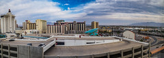 Downtown Las Vegas (Anthony's Olympus Adventures) Tags: lasvegas nevada nv usa america city downtownlasvegas downtown cityscape building architecture hotel hotelcasino casino cityview travel raw olympusem10 accommodation window downtowngrand ladyluckhotel tower 14thfloor microfourthirds morning panorama citycenter citycentre buildings hotelwindow sky clouds retouch postprocessing panoramic