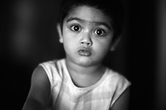 Little Mouth, Big Eyes (N A Y E E M) Tags: umar kalam son portrait yesterday morning bedroom home rabiarahmanlane chittagong bangladesh availablelight indoors naturallight lulu