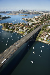Bridge, Sydney, Australia. (sousapp) Tags: color outdoors australia newsouthwales sydney aerial highway drummoyne harbor harbour water bridge skyscraper urban cityscape city skyline vacation tourism transportation travel traffic vertical architecture architectural boat boating coastal freeway marinescenes maritime motorway expressway road scenic sydneyharbour victoriaroad waterfront sailboat building structure photograph marina landscape