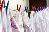 washed sheet hanging with clothespins (Mimadeo) Tags: blue white color wet cord clothing colorful pin bright air dry rope line clip clothes clean housework wash cotton laundry hanging sheet clothesline homework cloth hang washing clothespin detergent laundered