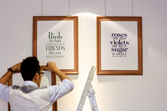 Lining up artwork frames (the little drm store) Tags: school red roses birds typography fly high poem friendship graduation exhibition retro nostalgia nostalgic forgetmenot joanne lim autographbook