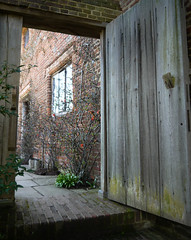 Through The Garden Door (Louise and Colin) Tags: door wood old uk england brick castle english heritage history window wooden sissinghurst kent gate britain steps eu explore brickwall british portal nationaltrust quince vitasackvillewest sissinghurstcastlegarden flickrexplore explored louiseenglish