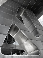 Legs of the Lowry (Claire Wroe) Tags: blackandwhite bw building monochrome metal architecture manchester mono hole theatre leg salford quays lowry