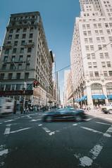 Jewelers on Fifth ( Nino) Tags: street new york city nyc newyorkcity sky urban film yellow clouds kodak manhattan cab taxi grain wide skyscrappers portra