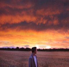 Farewell. (31/52) (alexanderbihn) Tags: light boy sunset red summer portrait sky orange cloud sun sunlight field rain clouds dream farewell alexander bihn bihni